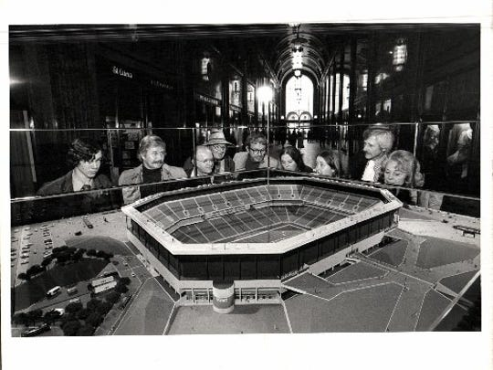 The architect's scale model of the new home of the Detroit Lions beginning in 1975 was on display in the lobby of the Fisher Building through November 1974. Built by O'Dell, Hewlett & Luckenbach, Birmingham architects for the 80,000-seat Pontiac Metropolitan Stadium, the model depicts a most unusual new football stadium, to be covered by the world's largest air-supported roof system. The model itself is unusual, too, in that the architect uses reflective mirrors to show a complete stadium from what is actually just one quarter of the complex.