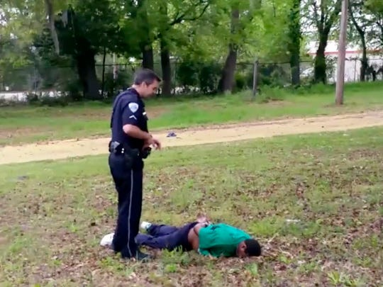 In this image from video, police officer Michael Thomas