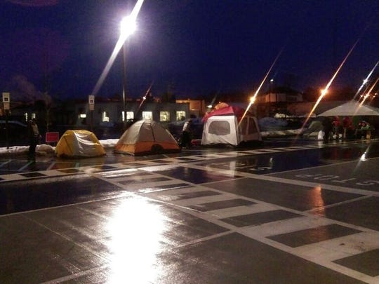 Campers braved the cold and rain early Wednesday morning in the parking lot of the new Flemington Chic-fil-A for a chance to win a year of Chik-fil-A meals. The fast-food chain opens Thursday.