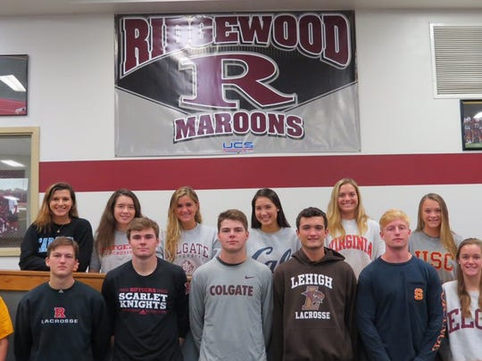 Ridgewood High School athletes show off their colleges on National Signing day on Nov. 8.