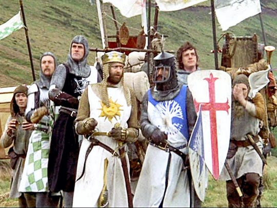 "King Arthur (Graham Chapman, front left) and his knights ride to Camelot in the 1975 movie ""Monty Python and the Holy Grail."""