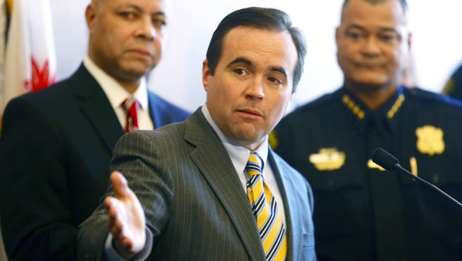 Mayor John Cranley holds a press conference with City Manager Harry Black, left, and Police Chief Jeffrey Blackwell Tuesday touting the city's drop  in crime.