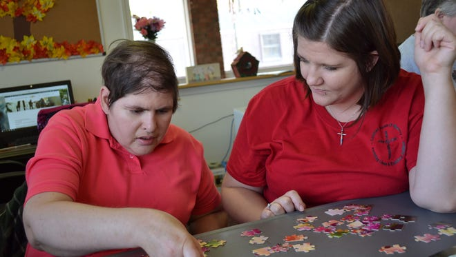 Habilitation Specialist Alexis Smith helps Lynn Kritzell put together a puzzle at State Street Options, a Day Habilitation Center that is a ministry of Luther Home of Mercies in Williston. On Giving Tuesday, Luther Home will partner with Bob Evans restaurant to raise money for a wheelchair-accessible vehicle for its Williston facility.
