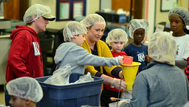 More than 160 members of Franklin  Road Academy package meals on Nov. 19, 2016. The meals were distributed to school feeding programs and big community development programs.