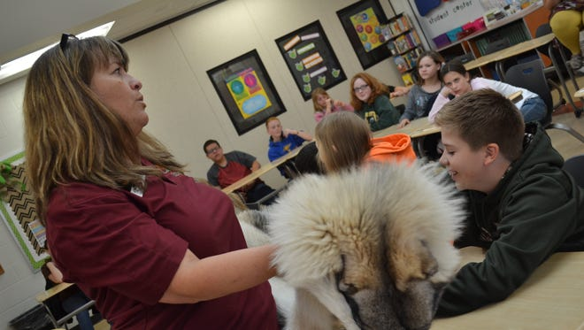 Deb Nofzinger brought animal furs and bones for her program on survival at McPherson Middle School.