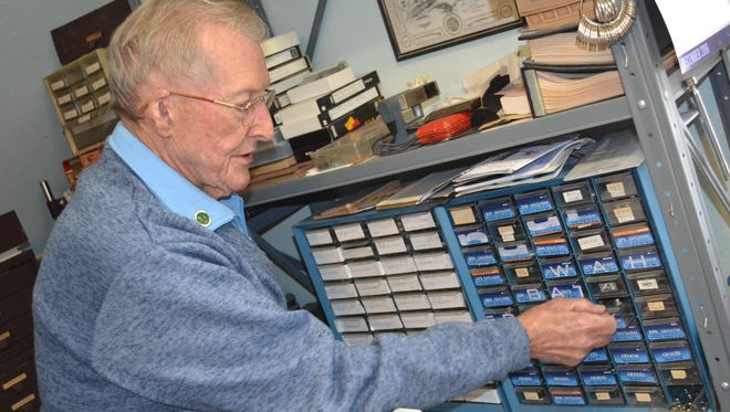 Richard Sneary keeps hundreds of watch batteries in his workshop.