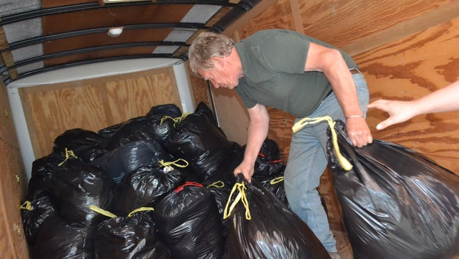 Ken Green loads some of the 80 bags of clothes, shoes, and purses he picked up from First Presbyterian Church after its annual Ladies Spring Rummage Sale on May 5. On May 13, Green delivered the items to Booneville, Kentucky, where Head Start workers distribute them to needy families.