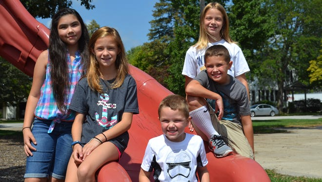 Students from Solomon Lutheran School, which has been educating local children for 155 years, take a break on the playground. Pictured are, left to right: Natalie Segovia, Madison Hammer, Jacob Karchner, Luke Karchner and Emma Hammer. Jacob and Luke are the fourth generation in their family to attend Solomon.