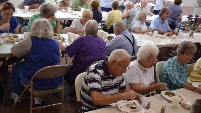 Between 70 and 90 people usually attend the monthly community meals held at St. Thomas Episcopal Church. So many attendees donate money for their meal that the project became self-sustaining a few years ago.