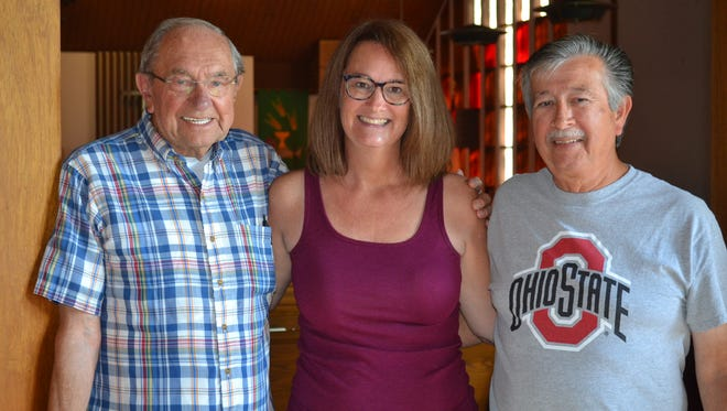 Charter member Hank Gurtz, left, Administrative Assistant Ellen Rofkar,  center, and trustee Roy Martinez stand inside Resurrection Lutheran Church, which celebrated its 50th anniversary on Sept. 10.