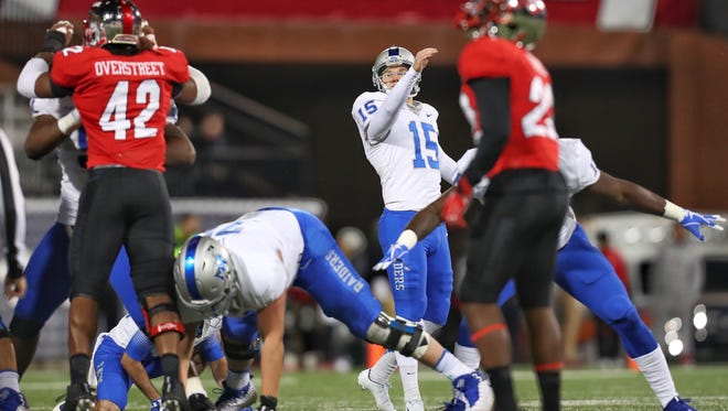 MTSU kicker Canon Rooker watches his 49-yard field goal attempt in the first half against Western Kentucky at Houchens Stadium on Nov. 17, 2017. Rooker's attempt clanked off the crossbar and through for his seventh field goal of 45 yards or longer this season.