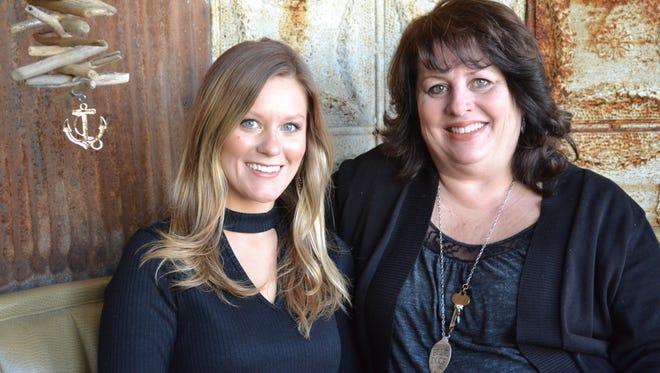 Lauren Shaw, left, with her mother, Laurie Shaw, at Blue Door.