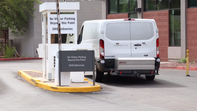 A white van pulls into the DHS deliveries area near ICE headquarters in Phoenix on July 10, 2018.