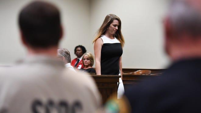 Kala Brown walks past Todd Kohlhepp, the serial killer who held her captive in 2016. The hearing, on July 11, 2018, marks the first time that Kohlhepp and Brown will be in the same courtroom since Brown's rescue on Nov. 3, 2016.