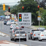 A silver Mazda sedan makes a rolling stop as the driver makes a right turn from Concord Ave. to N. Broom Street on Monday afternoon, August 18, 2014.