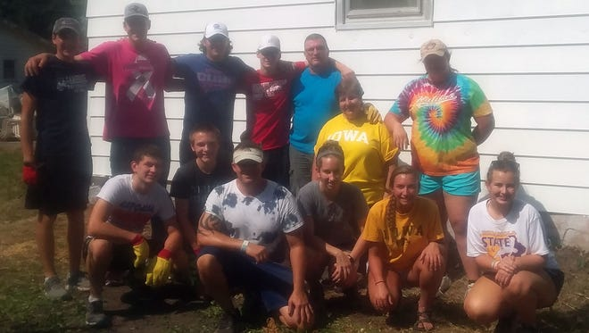 Volunteers with the St. Thomas Aquinas Teens usually do out-of-town mission work, but this year the kids decided to clean-up Indianola.  Those pictured include Connor Lynch, Sam Vonnahme, Joseph DeWall, James Rector, JoAnn Sayre, Nicole Kndley, Brock Elbert, Logan Grover, John Peters, Mallory Krpan, Gracey May and Tearani Peters.