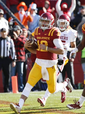 Quarterback Sam B. Richardson #12 of the Iowa State Cyclones scores a touchdown as cornerback Zack Sanchez #15 of the Oklahoma Sooners defends in the first half of play at Jack Trice Stadium on November 1, 2014 in Ames, Iowa.