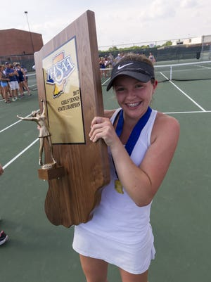 Carmel's No. 1 singles player, Lauren Lemonds, poses with the team's championship trophy after winning the 43rd Annual Girls' Tennis Team State Finals, Saturday,.