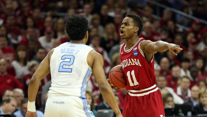 Indiana Hoosiers guard Yogi Ferrell (11) reacts as North Carolina Tar Heels guard Joel Berry II (2) defends during the first half in a semifinal game in the East regional of the NCAA Tournament at Wells Fargo Center.