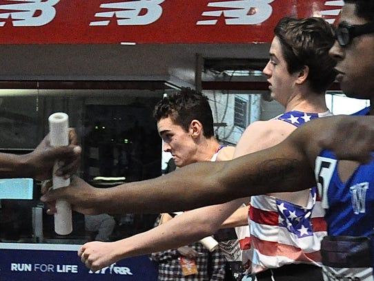 Bronxville's Alex Rizzo (center) takes baton from teammate