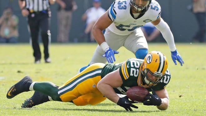 Green Bay Packers fullback Aaron Ripkowski (22) makes a catch fora short gain against the Detroit Lions outside linebacker Kyle Van Noy (53) at Lambeau Field  September 25, 2016.