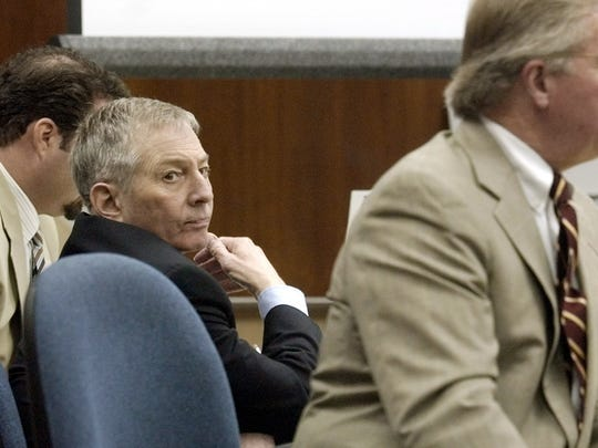 Robert Durst, center, looks toward the jury as his attorney Dick DeGuerin, right, questions a witness during his trial Monday, Oct. 13, 2003, in Galveston, Texas.