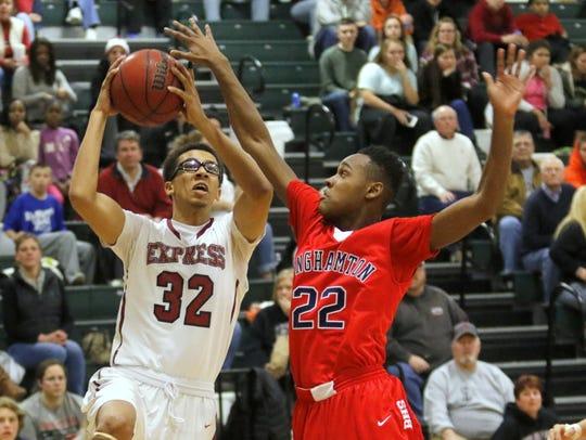 Elmira's Jadakis Brooks drives to the basket while