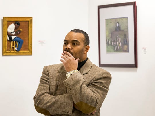 """Director Andre Jones watches a rehearsal of """"#BlackJobsMatter: A Wilmington Experiment""""  at the Chris White Gallery in Wilmington on Monday evening."""