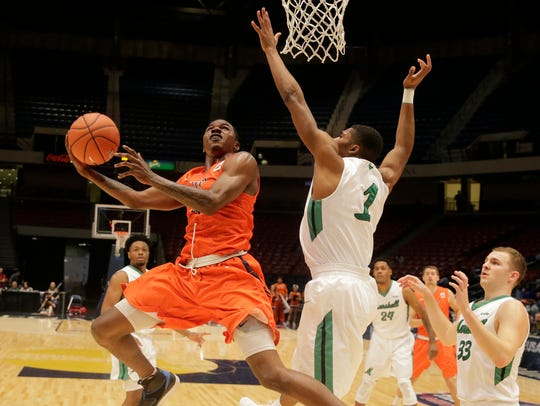 UTEP guard Lee Moore goes up for a shot against Marshall's