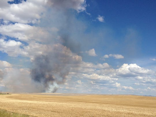 A fire burns off HIghwood Road east of Great Falls.