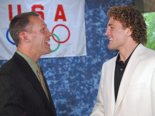 Arrowhead High School  wrestling coach John Mesenbrink (left) visits with former student and USA Olympic Wrestling team member Ben Askren in 2008. The two are inextricably linked in Arrowhead wrestling -- and Wisconsin state wrestling -- history.