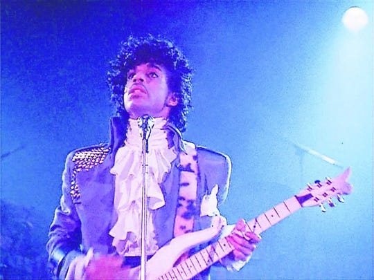 "Prince stars in ""Purple Rain."" The movie will be shown this week at  7:30 p.m. Friday at Premiere Cinemas Bassett in commemoration of the one year anniversary of the musician's death."