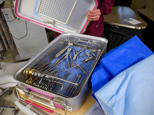 Jody Wessel, certified surgical technician, show reusable sterilization container Thursday, June 8, at the St. Cloud VA Health Care System. Previously surgical tools were wrapped in blue plastic which was not recyclable or reusable.