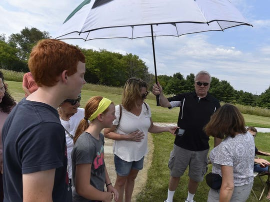 Viewers witness a totality solar eclipse from an earlier time zone with the help of a cellphone at the Ray and Ruthie Stonecipher Astronomy Center, 2200 Utah St., Sturgeon Bay, on Monday, Aug. 21, 2017. To see more photos, go to: www.doorcountyadvocate.com.