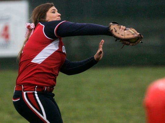 Oakland first baseman Savannah Lee catches a pop foul. Lee was named to the TSWA Class AAA Softball All-State team.