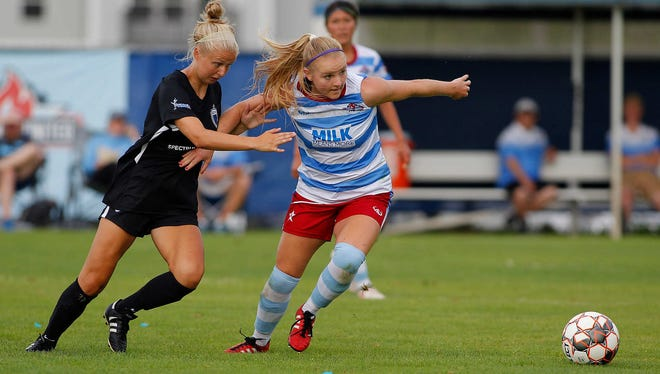 Lansing United's Alexis Mitchell, right, and Grand Rapids FC's Grace Labadie battle for the ball, Saturday, July 14, 2018, in East Lansing, Mich. Grand Rapids FC won 4-2.