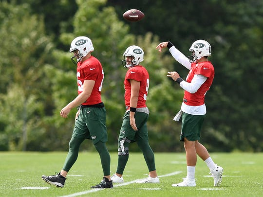 (L-R) New York Jets quarterbacks Josh McCown, Bryce Petty, and Christian Hackenberg participate in drills during practice in Florham Park, NJ on Monday, August 28, 2017.