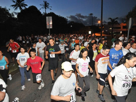 In this file photo, hundreds of participants rush off the starting line at the 23rd annual Rainbows 3.5 Mile Run Walk for Youth 2011 at the Micronesia Mall in Dededo on March 5.