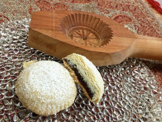 If you like Fig Newtons, you'll love mamoul, little buttery cookies filled with sweet dates. Each of these little gems is formed by hand in a wooden mamoul mold, then baked and dusted with powdered sugar.