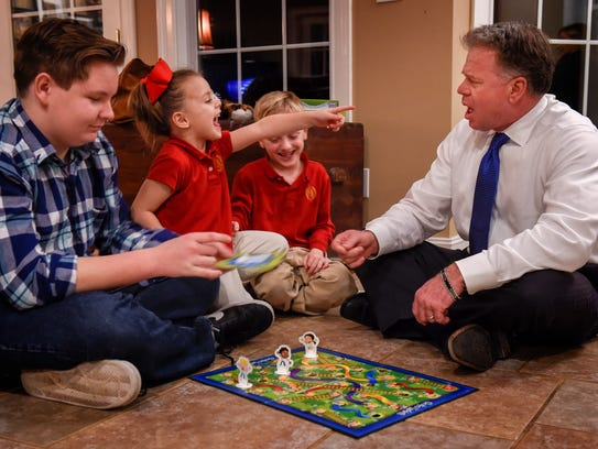 Judge Duane Slone plays Chutes and Ladders with his