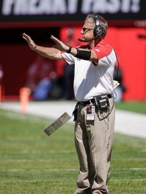 FILE -  In this Sept. 10, 2016, photo, Nebraska defensive coordinator Mark Banker signals to his players during the second half of an NCAA college football game against Wyoming, in Lincoln, Neb. Nebraska head coach Mike Riley has fired defensive coordinator Mark Banker, whose unit underperformed in some of the Cornhuskers' most important games, Wednesday, Jan. 11, 2017.