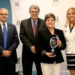 Patti Muxlow, Lake Regional's senior vice president of Clinical Services, accepts Lake Regional's Excellence in Donation Award from Rob Linderer, Midwest Transplant Network chief executive officer; Michael Dunaway, Missouri Hospital Association senior vice president of field operations; and Jan Finn Midwest Transplant Network chief operations officer.