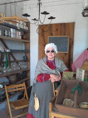 A costumed volunteer stays in character as she tells