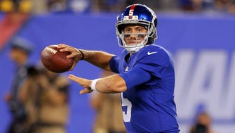 New York Giants quarterback Davis Webb (5) drops back to pass against the Pittsburgh Steelers during the fourth quarter of a preseason game at MetLife Stadium.