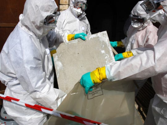 Removing materials containing some asbestos.