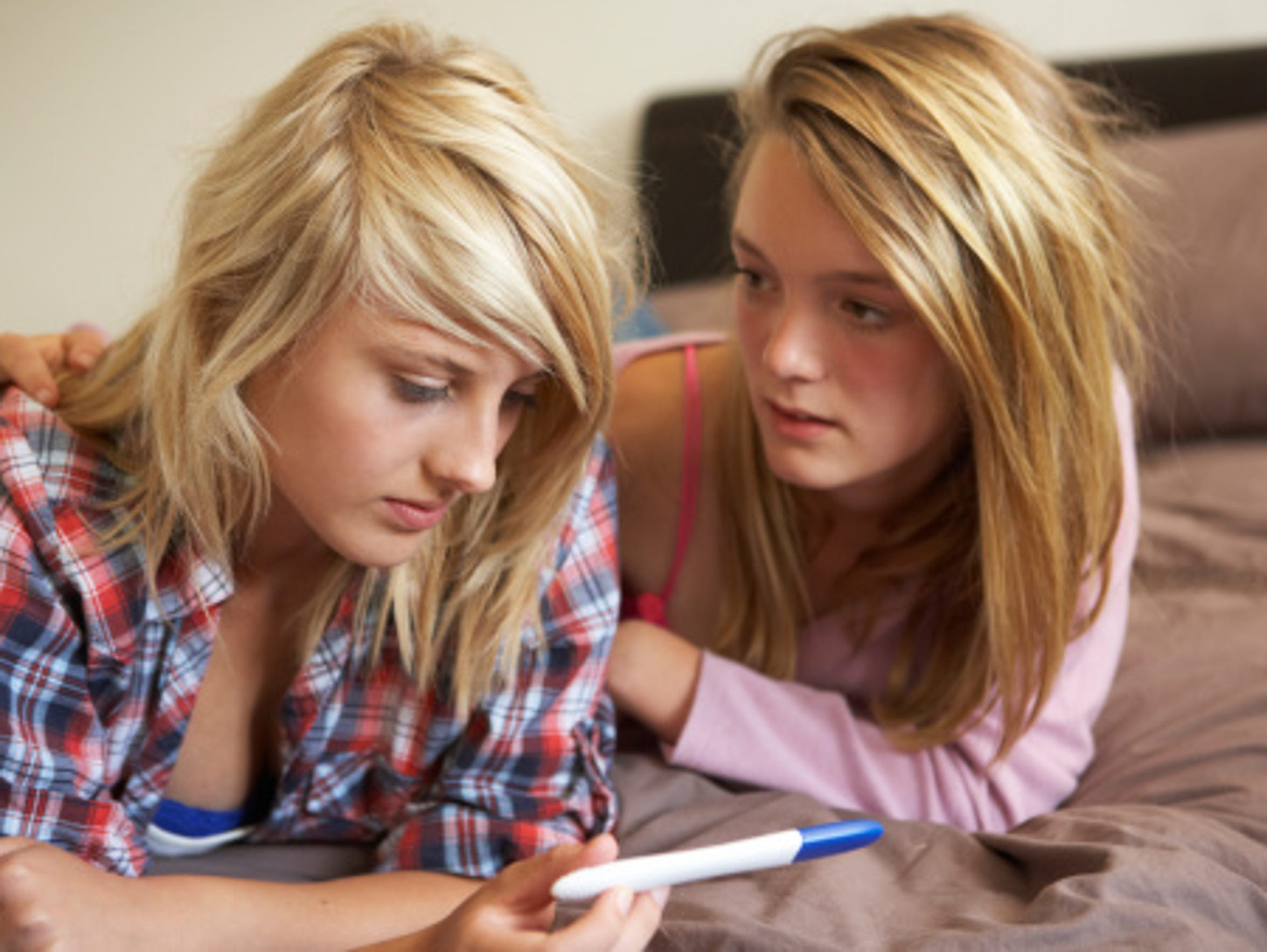This stock photo shows two teen girls looking at a