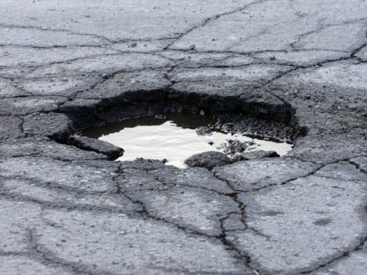 636519528355643890-pothole.jpg