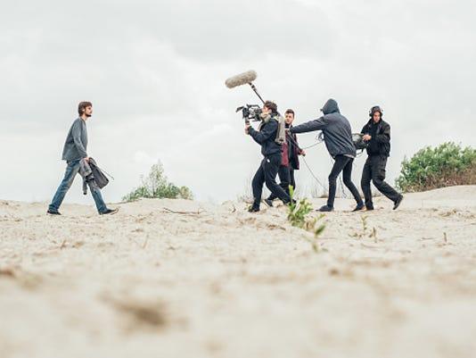 Film crew filming movie scene outdoor