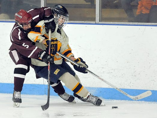 Aquinas' Tyler Kelly, left, takes down Irondequoit's Louis Cup.