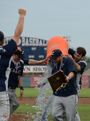 Lancaster baseball players Avery Baker and Alex Wilfing dump a cooler of ice and liquid onto Golden Gales Coach Corey Conn after Thursday's game, May 17, 2018, at Grove City High School in Grove City. The Golden Gales won the Central District Championship over Upper Arlington 8-5.